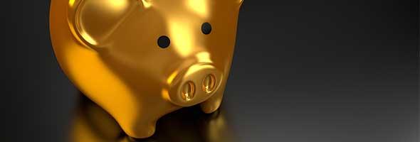 goud kopen uitgebeeld met gouden spaarvarken